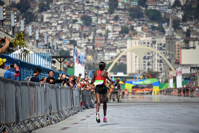 Kenya's Jemima Jelagat Sumgong runs to the finish line before winning the women's marathon during the Summer Olympics athletics event in Rio de Janeiro, Brazil, Sunday, August 14, 2016. (Photo by Johannes Eisele/Pool Photo via AP Photo)