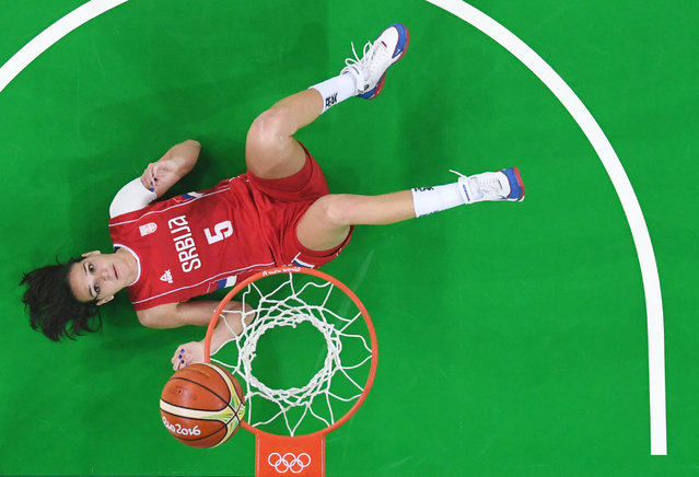 Serbia's forward Sonja Petrovic lying on the floor during the women's bronze medal basketball match between Serbia and France, August 20, 2016. (Photo by Mark Ralston/AFP Photo)