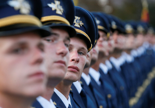 Ukrainian servicemen stand in a line during a rehearsal for the Independence Day military parade in central Kiev, Ukraine, August 22, 2016. (Photo by Valentyn Ogirenko/Reuters)