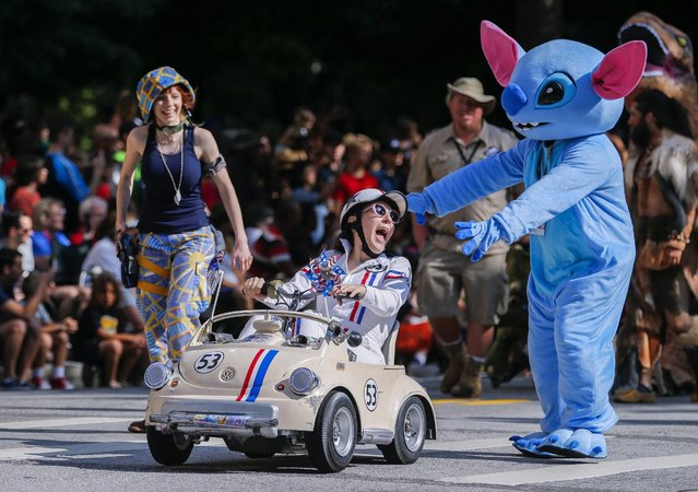 Costumed characters participate in the 30th annual Dragon Con Parade in Atlanta, Georgia, USA, 03 September 2016. Thousands of attendees crowd downtown Atlanta hotels and streets during the Labor Day weekend for the Dragon Con science fiction and fantasy convention, many dressed as their favorite characters. (Photo by Erik S. Lesser/EPA)