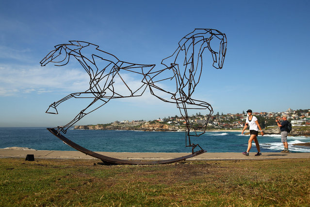 """Which Way Forwards"" by Harrie Fasher is displayed during the 2014 Sculptures by the Sea exhibition at Tamarama Beach on October 23, 2014 in Sydney, Australia. (Photo by Cameron Spencer/Getty Images)"
