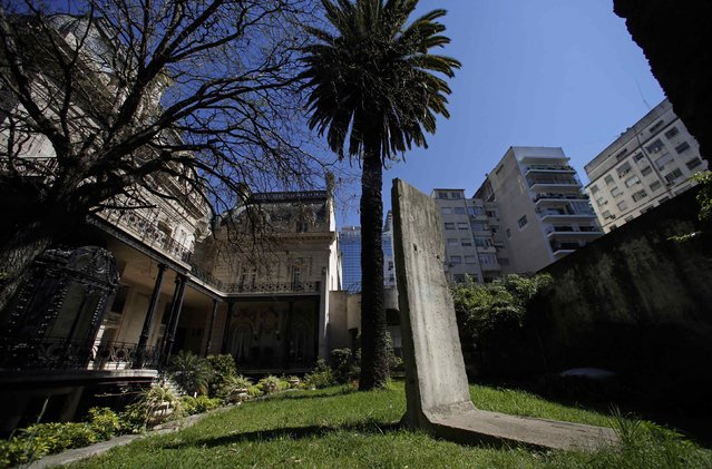 A piece of the Berlin Wall is seen at a garden inside San Martin palace, headquarters of Argentina's Foreign Ministry in Buenos Aires September 12, 2014. (Photo by Marcos Brindicci/Reuters)
