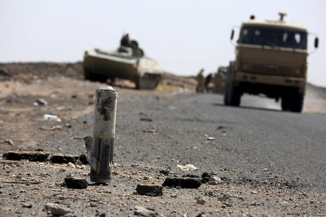 A truck passes near the fragments of a shell at the frontline of fighting against Houthi militants in the central province of Marib October 7, 2015. (Photo by Reuters/Stringer)