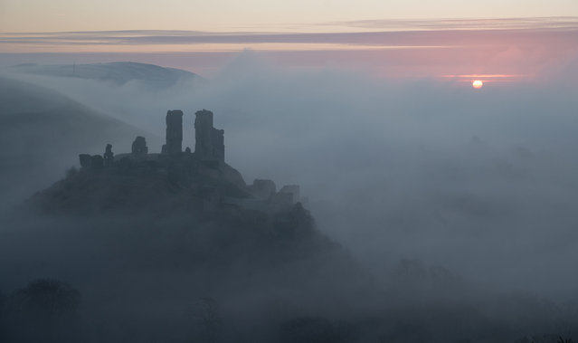 Sunrise over Corfe Castle where overnight temperatures again dipped below freezing in Dorset, England on January 21, 2020. (Photo by Andrew Matthews/PA Images via Getty Images)