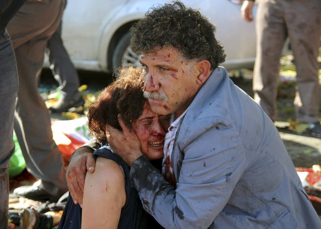 An injured man hugs an injured woman after an explosion during a peace march in Ankara, Turkey, October 10, 2015. (Photo by Tumay Berkin/Reuters)