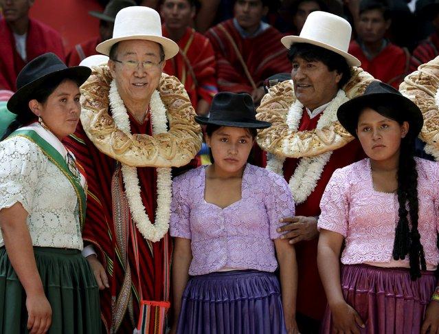 "U.N. Secretary-General Ban Ki-moon (2nd L) and Bolivia's President Evo Morales (2nd R) pose with residents of Vila Vila during the inauguration of a sports arena called ""Coliseo Ban Ki-Moon"" in Vila Vila, south of Cochabamba, October 11, 2015. (Photo by David Mercado/Reuters)"