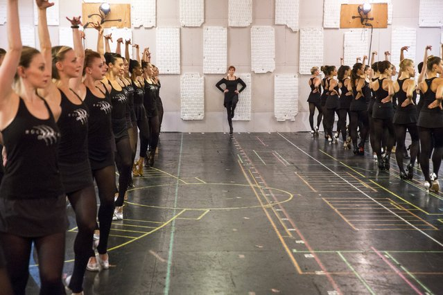 Julie Branam, director and choreographer for the Rockettes, watches as dancers rehearse for the Rockettes 2015 Radio City Christmas Spectacular in New York October 15, 2015. (Photo by Lucas Jackson/Reuters)
