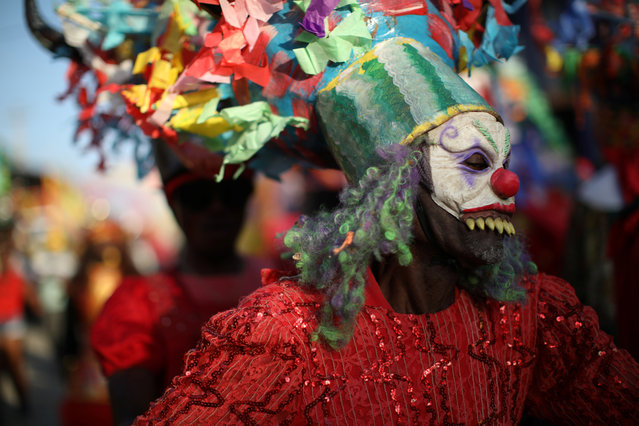 A reveller dances as he parades along a street at the Carnival of Jacmel, Haiti, February 4, 2018. (Photo by Andres Martinez Casares/Reuters)