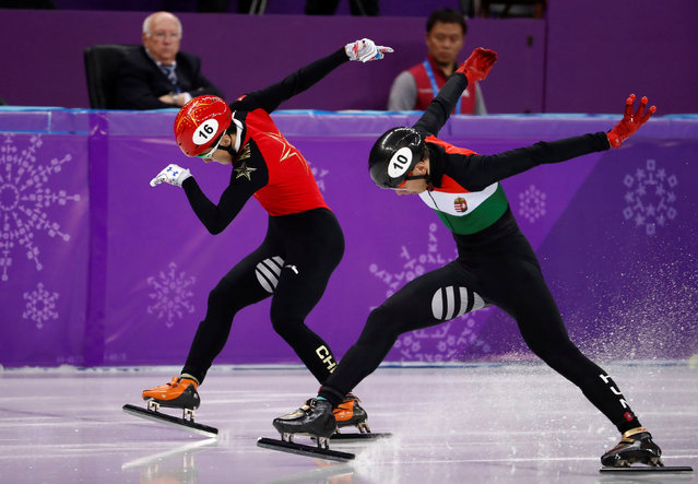 Hungary' s Sandor Liu Shaolin and China' s Ren Ziwei  compete in the men' s 500 m short track speed skating B final event during the Pyeongchang 2018 Winter Olympic Games, at the Gangneung Ice Arena in Gangneung on February 22, 2018. (Photo by Damir Sagolj/Reuters)