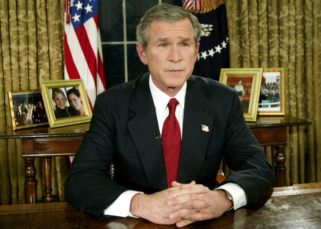 U.S. President George W. Bush announced the start of war between the United States and Iraq during a televised address from the Oval Office, on March 19, 2003. The United States said it had began its war against Iraq just minutes after several explosions were heard over Baghdad. (Photo by Kevin Lamarque/Reuters/The Atlantic)
