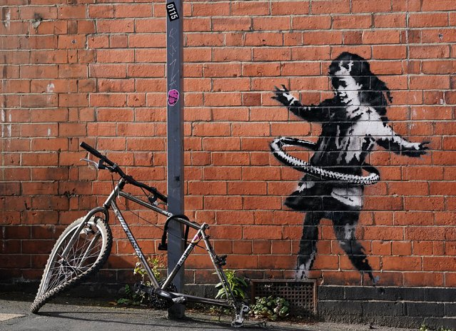 A new Banksy artwork is seen in Rothesay Avenue, Nottingham, Britain on October 17, 2020. (Photo by Carl Recine/Reuters)