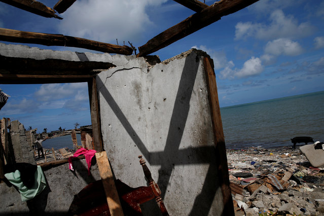 A man stands near the beach next to destroyed houses after Hurricane Matthew passes in Jeremie, Haiti, October 10, 2016. (Photo by Carlos Garcia Rawlins/Reuters)
