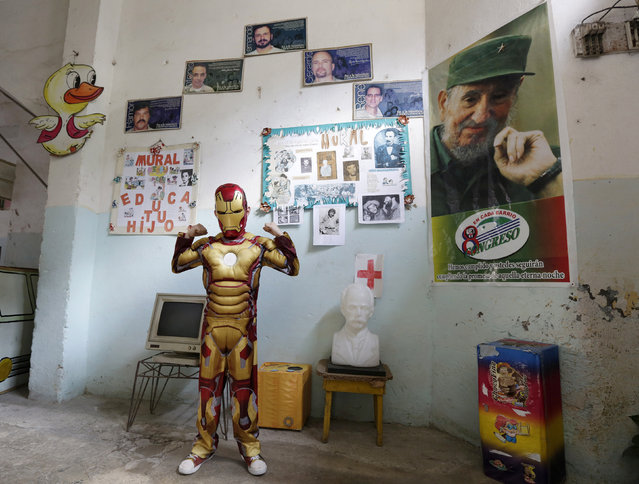 Third grade student at the Enrique Villuendas Primary School, Christian Jesus, 8, poses in his Iron Man costume as his school celebrates the 52nd anniversary of the Young Communist League (UJC) and the 53rd anniversary of the Jose Marti Pioneers Organization (OPJM) in Havana, April 4, 2014. (Photo by Enrique de la Osa/Reuters)