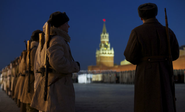 Russian soldiers dressed in Red Army World War II uniforms attend a rehearsal for the Nov. 7 parade in the Red Square with Spassky Tower in the background, in Moscow, Russia, Friday, November 6, 2015. The parade marks the 74th anniversary of a November 7 parade on Red Square when soldiers went directly to the front during World War II. For decades Nov. 7 was a holiday celebrating the 1917 Bolshevik Revolution. (Photo by Ivan Sekretarev/AP Photo)