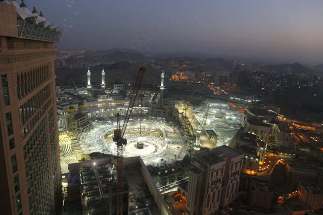 In this March 7, 2020 file photo, the sun sets at the site of the Grand Mosque, in the Muslim holy city of Mecca, Saudi Arabia, as authorities emptied Islam's holiest site for sterilization over fears of the new coronavirus. This was supposed to be Saudi Arabia's year to shine as host of the prestigious G20 gathering of world leaders. Instead, due to the pandemic, the gathering this November will likely be a virtual meet-up, stripping its host of the pomp that would have accompanied televised arrivals on Riyadh's tarmac. Even the upcoming hajj pilgrimage faces the possibility of being canceled or dramatically pared down. (Photo by Amr Nabil/AP Photo/File)