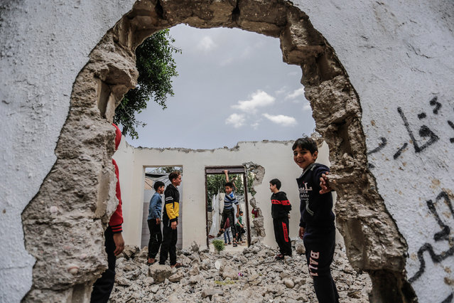 Palestinian refugees play in the town of Beit Lahia, north of Gaza City, December 6, 2020. (Photo by Mahmoud Issa/Quds Net News via ZUMA Wire/Rex Features/Shutterstock)