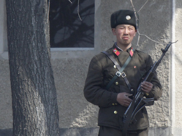 A North Korean soldier on the bank of the Yalu River, near the North Korean town of Sinuiju, along the Chinese border. (Photo by Jacky Chen/Reuters)