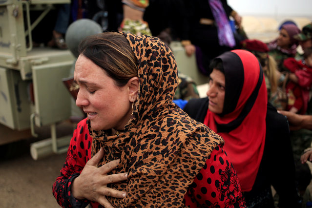 A newly internally displaced woman reacts upon her arrival at Al Khazar camp near Hassan Sham, east of Mosul, Iraq October 28, 2016. (Photo by Zohra Bensemra/Reuters)