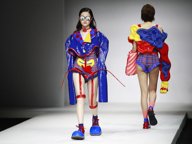 Models show creations by Chinese graduates from the China Academy of Art School of Design during the Show Town China Graduate Fashion Week in Beijing, China, 13 May 2018. (Photo by How Hwee Young/EPA/EFE)