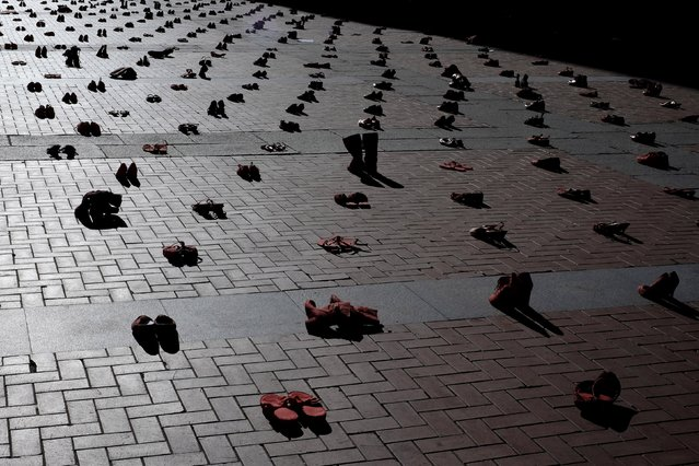 Red shoes are seen placed at Plaza Mayor, as part of an installation to protest against gender violence and femicide, in Valladolid, Spain November 25, 2015. A total of 1800 red women shoes are placed at the Plaza Mayor of Valladolid as Wednesday marks the International Day for the Elimination of Violence Against Women. (Photo by Juan Medina/Reuters)