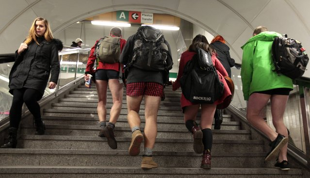 """Passengers not wearing pants walk up the stairs through a subway train transfer tunnel during the """"No Pants Subway Ride"""" in Prague January 11, 2015. (Photo by David W. Cerny/Reuters)"""