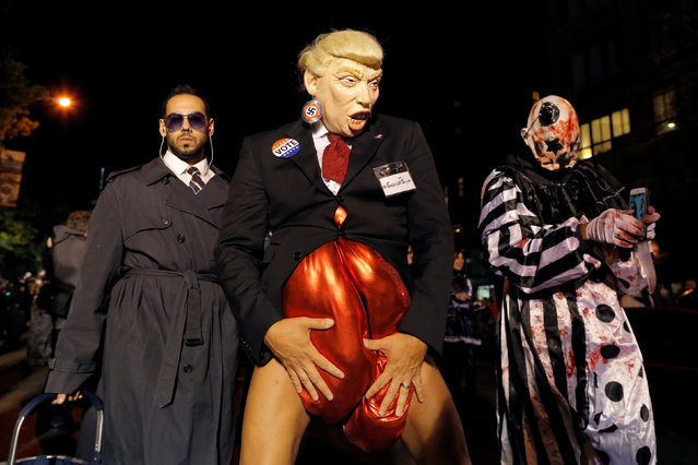 A person dressed as Republican presidential nominee Donald Trump participates in the Greenwich Village Halloween Parade in Manhattan, New York, U.S., October 31, 2016. (Photo by Andrew Kelly/Reuters)