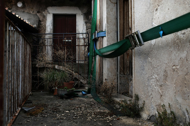 Thick belts are tied around a building to prevent further damage after it was damaged by a strong earthquake, near the old centre of the town of Catsel Vecchio in the province of L'Aquila in Abruzzo, inside the national park of the Gran Sasso e Monti della Laga, Italy, September 11, 2016. (Photo by Siegfried Modola/Reuters)