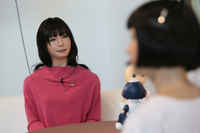 "Humanoid robot ""Otonaroid"" talks with ""Kodomoroid"" during the press conference to introduce the sociable robots, ""CommU"" and ""Sota"" hosted by only the robot science communicator Otonaroid and the robot anchor Kodomoroid at the National Museum of Emerging Science and Technology (Miraikan) on January 20, 2015 in Tokyo, Japan. (Photo by Ken Ishii/Getty Images)"