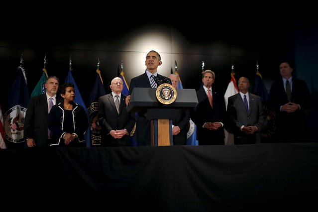 U.S. President Barack Obama delivers a statement at the National Counterterrorism Center in Mclean, Virginia, December 17, 2015. Standing with the President (L-R) are: Nicholas Rasmussen, Director, National Counterterrorism Center, Attorney General Loretta Lynch, James Clapper, Director, Office of National Intelligence, Vice President Joe Biden, Secretary John Kerry, Secretary of Homeland Security Jeh Johnson and James Comey, Director, Federal Bureau of Investigations. (Photo by Carlos Barria/Reuters)