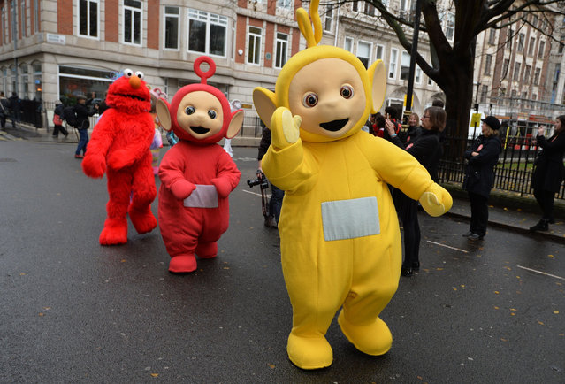 Teletubbies and a Muppet prepare to start the Hamleys Christmas toy parade on Regent Street in London, UK on November 20, 2016. (Photo by John Stillwell/PA Wire)