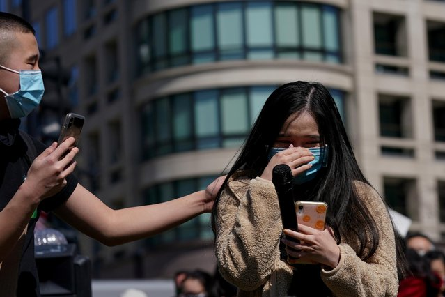 Anita Kuang, a university student, becomes emotional as she speaks at a rally to protest recent violence against people of Asian descent, at McPherson Square near the White House in Washington, U.S. March 21, 2021. (Photo by Erin Scott/Reuters)