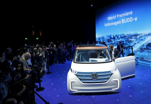 Journalists take a look at the Volkswagen BUDD-e electric vehicle after its unveiling during a keynote address at the  2016 CES trade show in Las Vegas, Nevada, January 5, 2016. (Photo by Steve Marcus/Reuters)