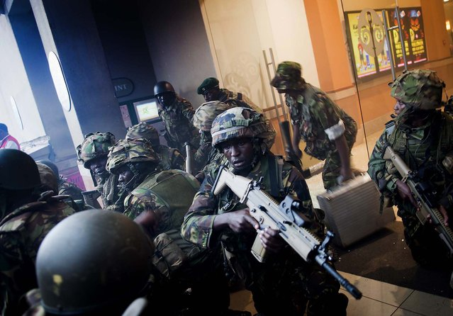 Armed police leave after entering the Westgate Mall. (Photo by Jonathan Kalan/Associated Press)