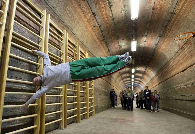A teacher exercises in the facilities of Belarus' Republican Clinic of Speleotherapy within a salt mine near the town of Soligorsk, south of Minsk, February 19, 2015. (Photo by Vasily Fedosenko/Reuters)