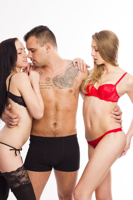 Sеxy swinger threesome on white isolated background. (Photo by Getty Images/iStockphoto)