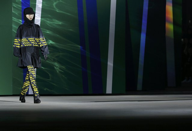 A model presents a creation by designers Humberto Leon and Carol Lim as part of their Autumn/Winter 2015/2016 women's ready-to-wear collection for Japanese fashion house Kenzo during Paris Fashion Week March 8, 2015.    REUTERS/Gonzalo Fuentes (FRANCE  - Tags: FASHION)