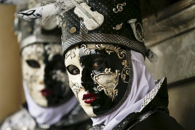 Masked revellers pose during the Venice Carnival, in Piazza San Marco January 30, 2016. (Photo by Alessandro Bianchi/Reuters)