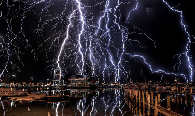 Dramatic lightning strikes over Perth Harbor in Australia. (Photo by Oliver Kay/Caters News)
