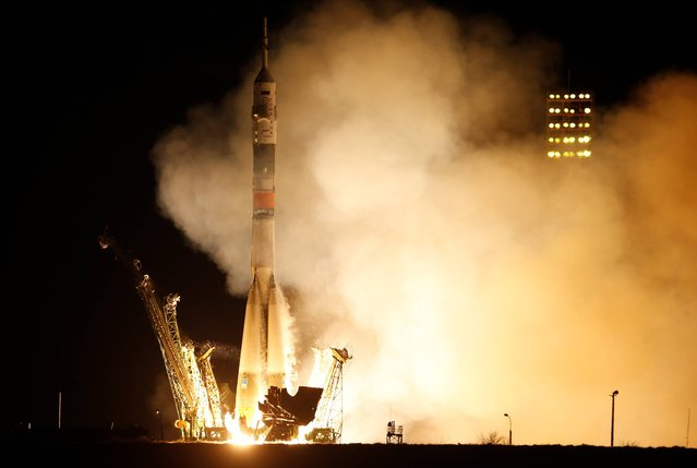 The Soyuz-FG rocket booster with Soyuz TMA-16M space ship carrying a new crew to the International Space Station, ISS, blasts off at the Russian leased Baikonur cosmodrome, Kazakhstan, Saturday, March 28, 2015. The Russian rocket carries U.S. astronaut Scott Kelly, Russian cosmonauts Gennady Padalka and Mikhail Korniyenko. (Photo by Dmitry Lovetsky/AP Photo)