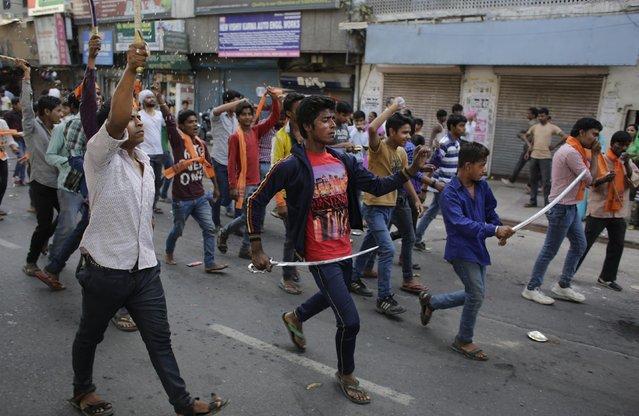 Hindus brandishing swords participate in a religious procession on Ram Navami festival in New Delhi, India, Saturday, March 28, 2015. (Photo by Altaf Qadri/AP Photo)