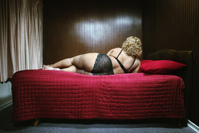 Mature woman lying on bed, rear view. (Photo by Andersen Ross/Getty Images)