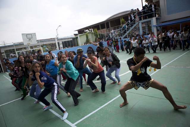 """In this August 25, 2017 photo, Muay Thai practitioners lead mostly female students at a nursing school in a self-defense workshop in Nezahualcoyotl, Mexico state. """"We want to help them prepare in case they have to defend themselves"""", martial arts instructor Cristofer Fuentes said. (Photo by Rebecca Blackwell/AP Photo)"""
