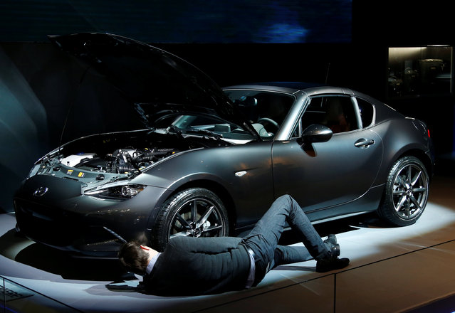 A man inspects a Mazda MX-5RF car at the European Motor Show in Brussels, Belgium, January 13, 2017. (Photo by Francois Lenoir/Reuters)