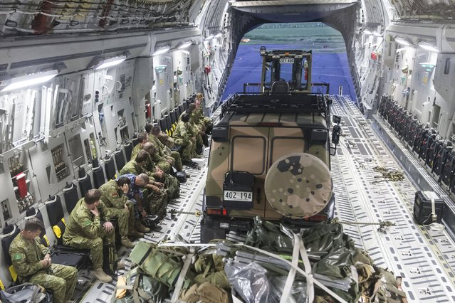 Members of Joint Task Force 635 reconnaissance and assessment team prepare to disembark a Royal Australian Air Force C-17A aircraft upon their arrival at Nausori airport near Fiji's Cyclone Winston-hit capital Suva, in this handout image supplied by the Australian Defence Force on February 23, 2016. (Photo by Reuters/Australian Defence Force)