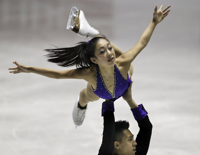 Sui Wenjing and Han Cong of China perform during the pairs short program at the World Team Trophy Figure Skating Championships in Tokyo, Friday, April 17, 2015. (Photo by Koji Sasahara/AP Photo)