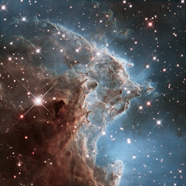 This infrared image made by the NASA/ESA Hubble Space Telescope shows part of NGC 2174, the Monkey Head Nebula. The structure lies about 6400 light-years away in the constellation of Orion (The Hunter). The Hubble Space Telescope marks its 25th anniversary. A full decade in the making, Hubble rocketed into orbit on April 24, 1990, aboard space shuttle Discovery. (Photo by NASA/ESA/Hubble Heritage Team (STScI/AURA) via AP Photo)