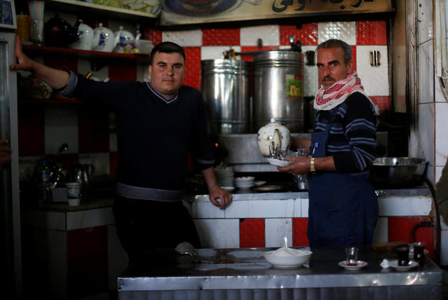 Restaurant workers are pictured at al Zohour area in Mosul, Iraq, January 23, 2017. (Photo by Muhammad Hamed/Reuters)