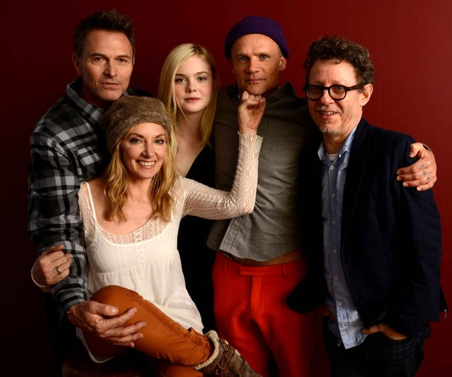 (L-R) Actor Timothy Daly, filmmaker Amy-Jo Albany, actors Elle Fanning and Flea, and filmmaker Jeff Preiss pose for a portrait during the 2014 Sundance Film Festival at the WireImage Portrait Studio at the Village At The Lift on January 20, 2014 in Park City, Utah. (Photo by Larry Busacca/AFP Photo)