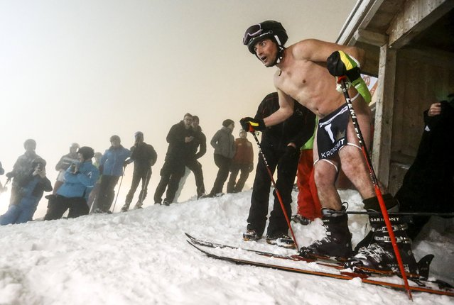 """A competitor starts during a fun """"Naked Slalom Skirace"""" in the western Austrian ski resort of Steinach am Brenner, March 12, 2016. (Photo by Dominic Ebenbichler/Reuters)"""
