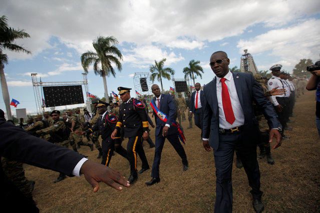 Haitian President Jovenel Moise (C) and National Police Chief Michel-Ange Gedeon look over National Police officers at the inauguration in the National Palace of Port-au-Prince, Haiti February 7, 2017. (Photo by Andres Martinez Casares/Reuters)